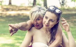 Mother and daughter while posing hugged together in swimsuit stock image