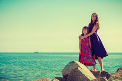 Mother and daughter posing at sea rocks Stock Image