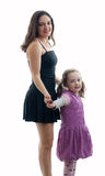 Mother and daughter posing in the studio Royalty Free Stock Images