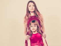 Mother and daughter posing together Royalty Free Stock Photos