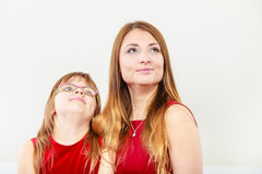 Mother and daughter posing together Royalty Free Stock Image