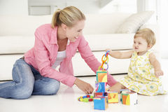 Mother and Daughter Pplaying Together At Home Royalty Free Stock Photography