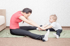 Mother and daughter practicing yoga Royalty Free Stock Image