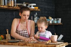 Mother and daughter prepare cookies in kitchen Royalty Free Stock Image