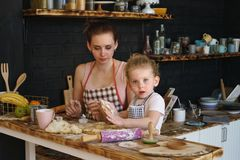 Mother and daughter prepare cookies in kitchen Royalty Free Stock Photography