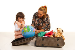 Mother and daughter prepare for travel Stock Photos