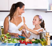 Mother and daughter prepare vegetables Royalty Free Stock Photo