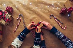 A mother and daughter prepare Xmas gifts. Top view. Christmas family traditions. stock photos