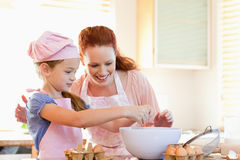 Mother and daughter preparing cookies. Together stock photo