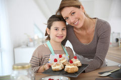Mother and daughter preparing deserts Royalty Free Stock Photography
