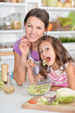 Mother and daughter preparing dinner. Together on kitchen Stock Photography