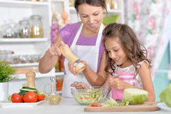 Mother and daughter preparing dinner. Together on kitchen Stock Photo