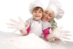Mother and daughter preparing dough Royalty Free Stock Image