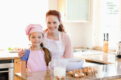 Mother and daughter preparing dough Royalty Free Stock Photo