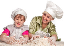 Mother and daughter preparing dough Royalty Free Stock Photos