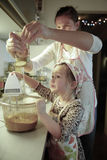Mother and daughter preparing dough in the kitchen Royalty Free Stock Photo