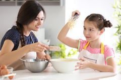 Mother and daughter preparing dough Royalty Free Stock Photography