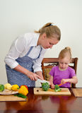 Mother and daughter preparing food. Royalty Free Stock Photos