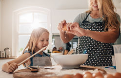 Mother and daughter preparing food in kitchen Royalty Free Stock Images