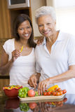 Mother And Daughter Preparing A Meal Stock Photos