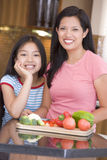 Mother And Daughter Preparing A Meal Royalty Free Stock Images