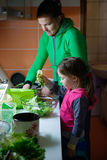 Mother and daughter preparing a meal Stock Photo