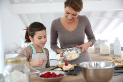 Mother and daughter preparing pastries royalty free stock images