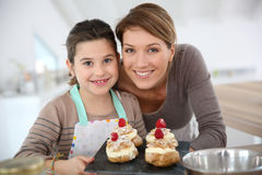 Mother and daughter preparing pastries Stock Photo