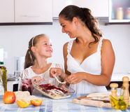 Mother and daughter preparing pie Stock Photo