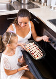 Mother and daughter preparing pie Stock Photos