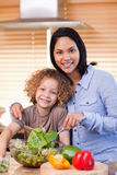 Mother and daughter preparing salad Royalty Free Stock Image