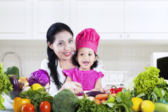 Mother and daughter preparing salad Stock Images