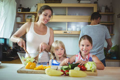 Mother and daughter preparing salad in the kitchen Royalty Free Stock Photography