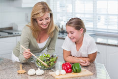 Mother and daughter preparing salad together Royalty Free Stock Photography