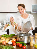 Mother and daughter preparing soup Royalty Free Stock Image