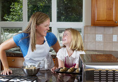 Mother and daughter preparing to bake cookies Royalty Free Stock Photos