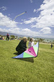 A mother and daughter preparing to fly a kite. On April 15, 2007, at the Santa Barbara Kite Festival, Santa Barbara City College, overlooking Pacific Ocean Stock Images