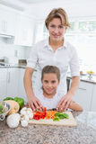 Mother and daughter preparing vegetables Royalty Free Stock Photo