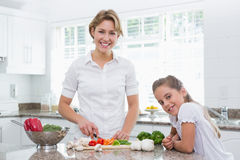 Mother and daughter preparing vegetables Royalty Free Stock Images