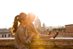Mother and daughter in profile at sunset with St. Peters Royalty Free Stock Photo