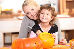 Mother and daughter with pumpkin Royalty Free Stock Photos