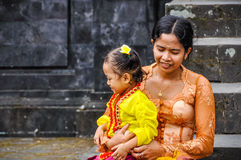 Mother and daughter in Pura Besakih Temple, Bali, Indonesia Royalty Free Stock Photography