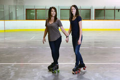 Mother daughter quad roller skating focus on mother Stock Photography