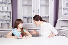 Mother and daughter quarrel because of overuse technology Royalty Free Stock Photo