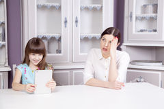 Mother and daughter quarrel because of overuse technology Stock Photos