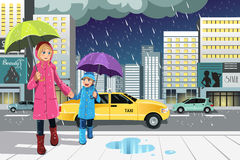 Mother daughter in the rain. A vector illustration of a mother and a daughter walking in the rain in the city Stock Images