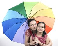 Mother and daughter in rain stock photos