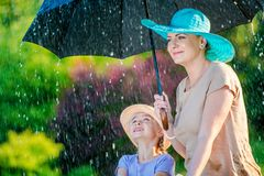 Mother with Daughter in Rain Royalty Free Stock Image