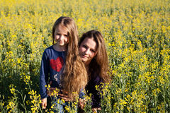 Mother and daughter in rape field Royalty Free Stock Images