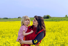 Mother and daughter in rapefield Stock Image